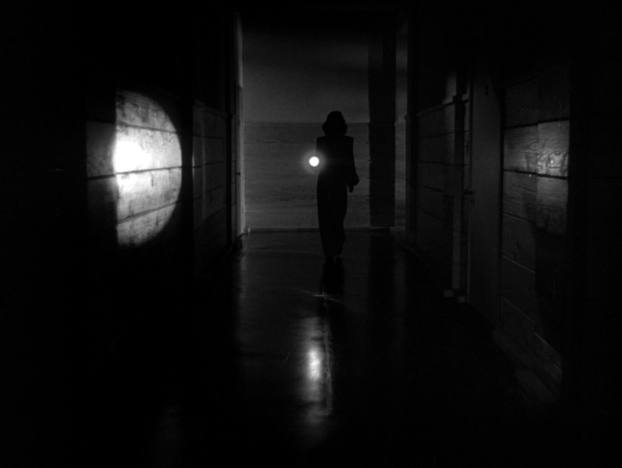 https://www.film-rezensionen.de/wp-content/uploads/2011/06/Geheimnis-hinter-der-T%c3%bcr-Frontpage.jpg