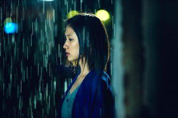 A Woman Wavering in the Rain